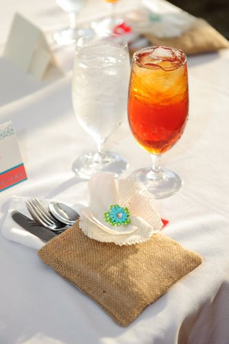 Fabric flower and burlap sack place setting